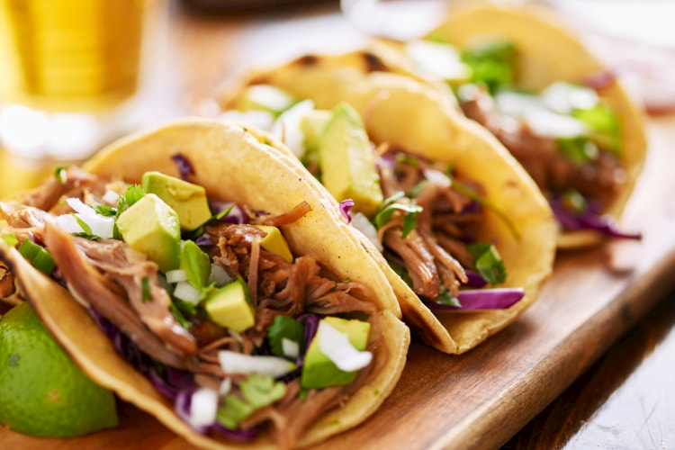 carnitas-tacos-on-wooden-tray