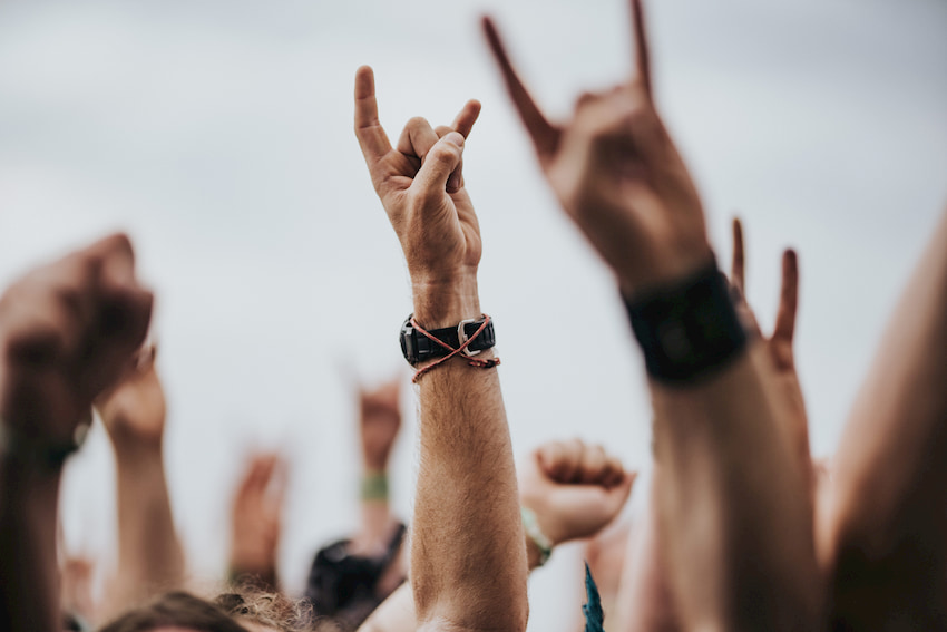 hands raise during a rock music performance