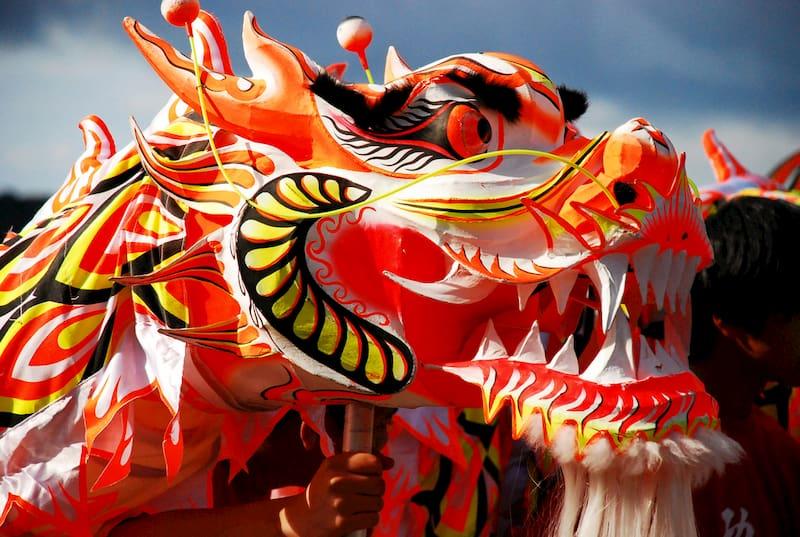 a golden dragon costume prepares for the LA golden dragon parade