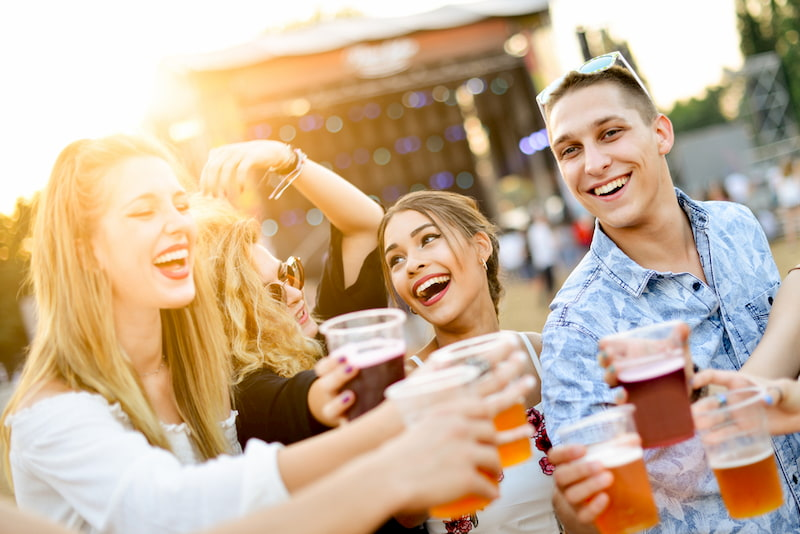friends cheers at a beer festival in los angeles, california