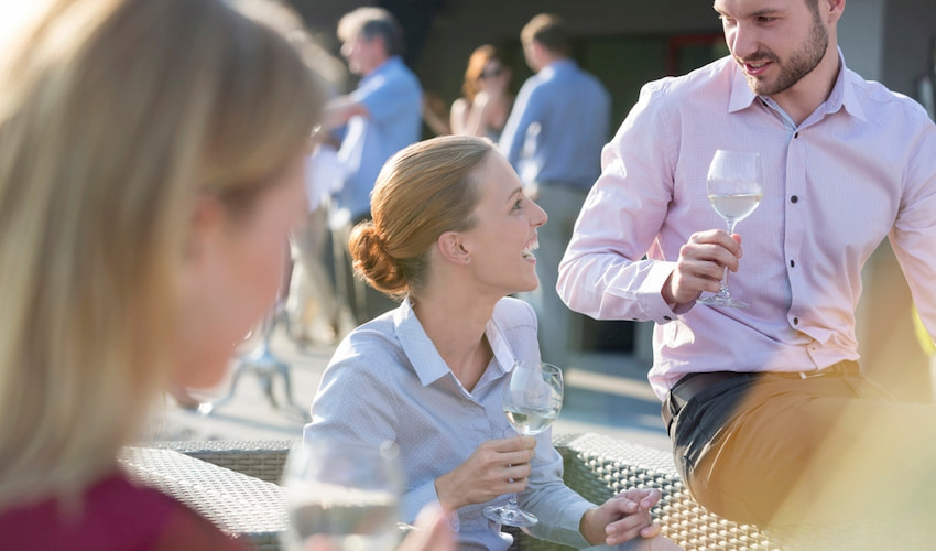 employees sip wine and chat at a corporate event in Los Angeles California