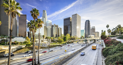 view of downtown Los Angeles from a busy highway