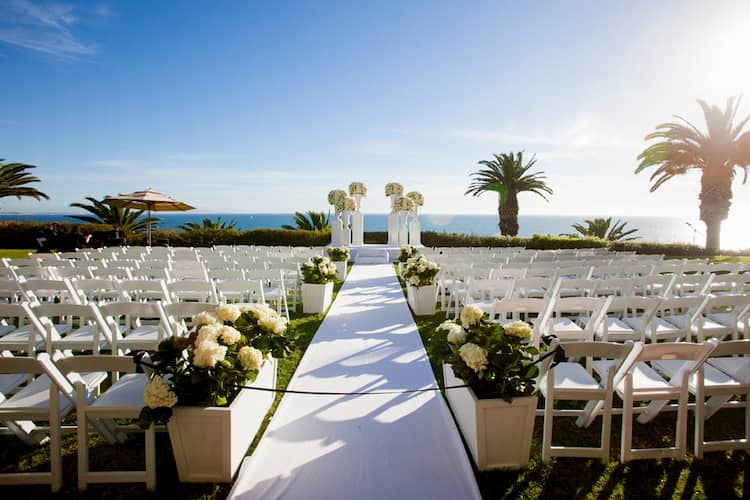 Wedding ceremony on bluffs in front of ocean at Bel-Air