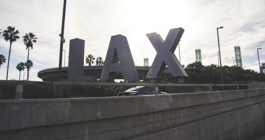 "the ""LAX"" sign outside Los Angeles International Airport"