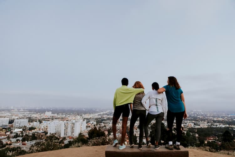 Friends overlooking LA from the mountains