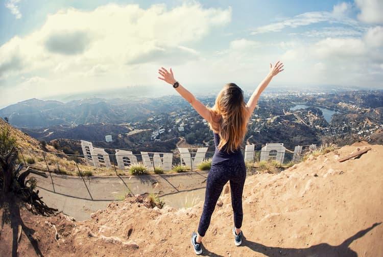 Hiker behind Hollywood Sign