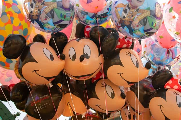 A bunch of Mickey Mouse and Minnie Mouse balloons