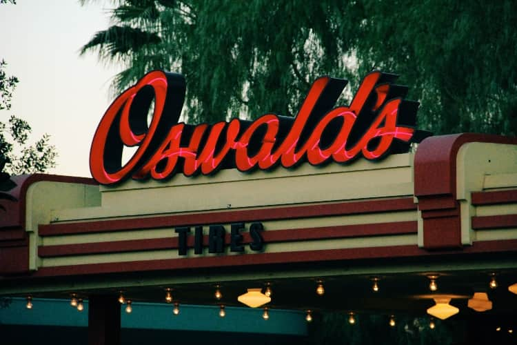 "A neon red sign with the name ""Oswald's"""