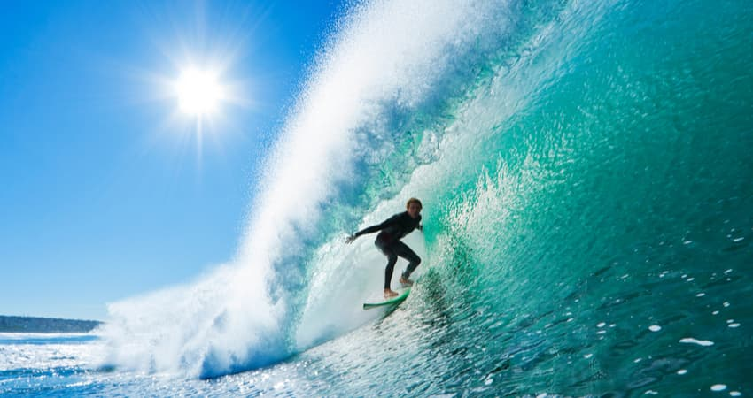 A surfer in a barrel wave