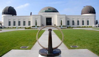 the front lawn of griffith observatory on a sunny day