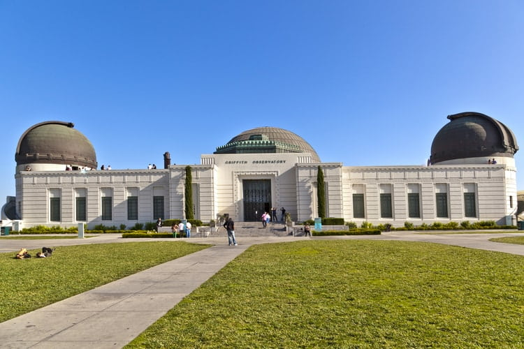the green lawn in front of griffith observatory on a clear day
