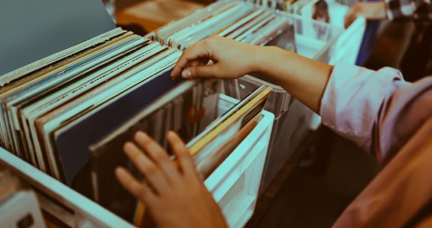 A customer browsing through vinyl records